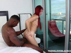 Big ass redhead has an interracial fuck fest with thug