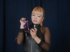 Purple leather armbinder and gag